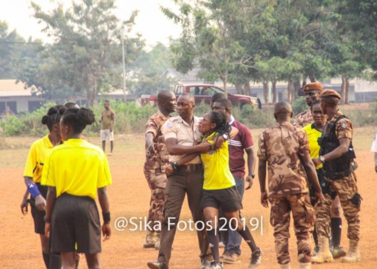 Referee Bremansu being escorted off the field by some Prisons officers after the assault (Image credit: Sika Photos)
