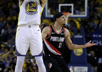 The Warriors' Stephen Curry shooting in front of his brother, the Portland Trail Blazers' Seth Curry.CreditCreditBen Margot/Associated Press