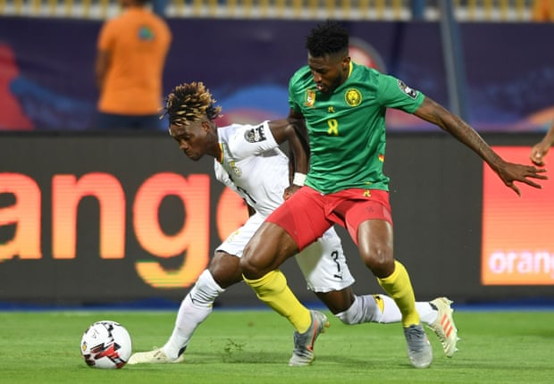Ghana's midfielder Christian Atsu fights for the ball with Cameroon's midfielder Andre-Frank Zambo Anguissa. Photograph: Ozan Köse/AFP/Getty Images