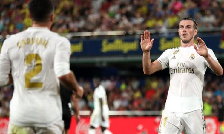 Gareth Bale (right) becomes only the second Real Madrid player, after Cristiano Ronaldo, to score a La Liga double and be sent off in the same match this century (Image credit: Getty Images)