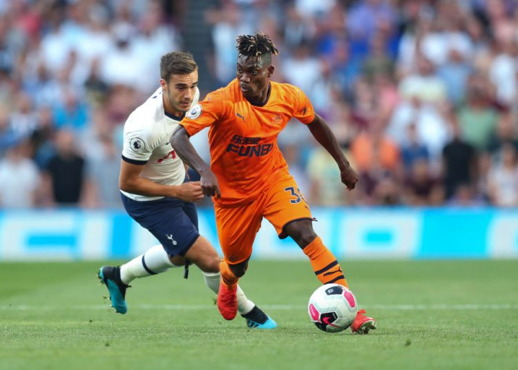 LONDON, ENGLAND - AUGUST 25: Christian Atsu of Newcastle United and Harry Winks of Tottenham Hotspur during the Premier League match between Tottenham Hotspur and Newcastle United at Tottenham Hotspur Stadium on August 25, 2019 in London, United Kingdom. (Photo by Catherine Ivill/Getty Images)