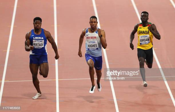 DOHA, QATAR - SEPTEMBER 27: (L-R) Emmanuel Matadi of Liberia, Zharnel Hughes of Great Britain, and Joseph Paul Amoah of Ghana compete in the Men's 100 metres heats during day one of 17th IAAF World Athletics Championships Doha 2019 at Khalifa International Stadium on September 27, 2019 in Doha, Qatar. (Photo by Patrick Smith/Getty Images)