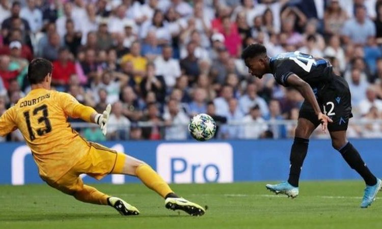 Emmanuel Dennis almost fell before chipping in Club Bruges' second goal (Image credit: Getty Images)