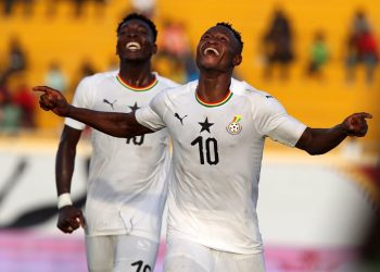 Esso (in jersey number 10) celebrating his goal for Ghana against The Gambia