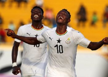 Joseph Esso (in jersey number 10) celebrating his goal against The Gambia