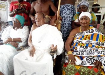 Nana Akuoko Sarpong (in white cloth) sitting in state at a durbar
