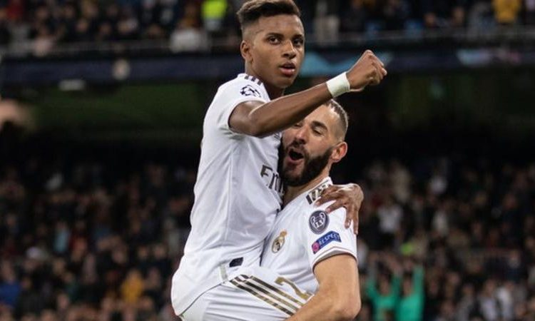 Rodrygo (left) completed his hat-trick in stoppage time after Karim Benzema's brace (Image credit: Rex Features)