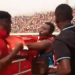 Patrick Allotey draws back his fist preparing to hit the fan