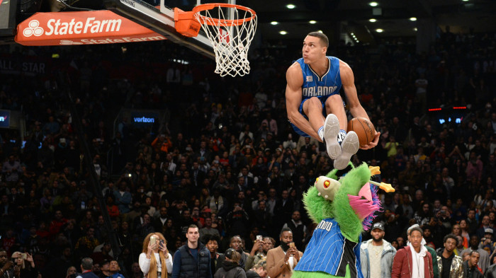 TORONTO, CANADA - FEBRUARY 13:  (12 of 20) Aaron Gordon #00 of the Orlando Magic goes up for a dunk over the Orlando Magic mascot during the Verizon Slam Dunk Contest as part of 2016 NBA All-Star Weekend. Getty Images. Copyright 2016 NBAE  (Photo by Garrett Ellwood/NBAE via Getty Images)