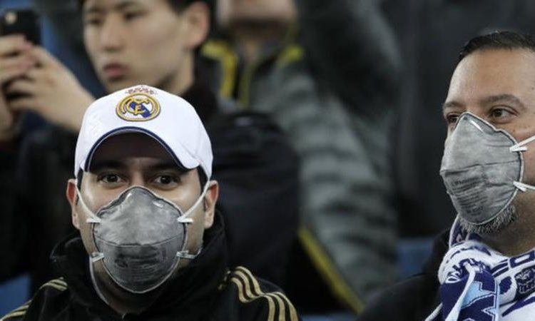 Real Madrid fans wear masks at a recent game at the Bernabeu (Image credit: Getty Images)