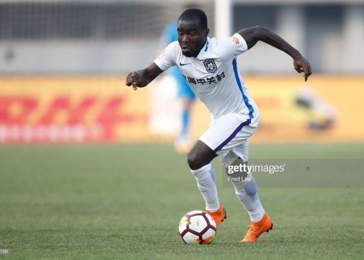 BEIJING, CHINA - APRIL 28:  Frank Acheampong #7 of Tianjin Teda  in action during 2018 China Super League match between Beijing Renhe and Tianjin Teda at Beijing Fengtai Stadium on April 28, 2018 in Beijing, China.  (Photo by XIN LI/Getty Images)