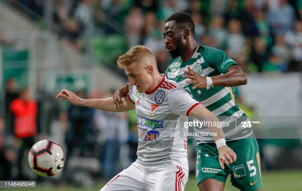 BUDAPEST, HUNGARY - MAY 11: (r-l) Abraham Frimpong of Ferencvarosi TC challenges Kevin Varga of DVSC during the Hungarian OTP Bank Liga match between Ferencvarosi TC and DVSC at Groupama Arena on May 11, 2019 in Budapest, Hungary. (Photo by Laszlo Szirtesi/Getty Images)