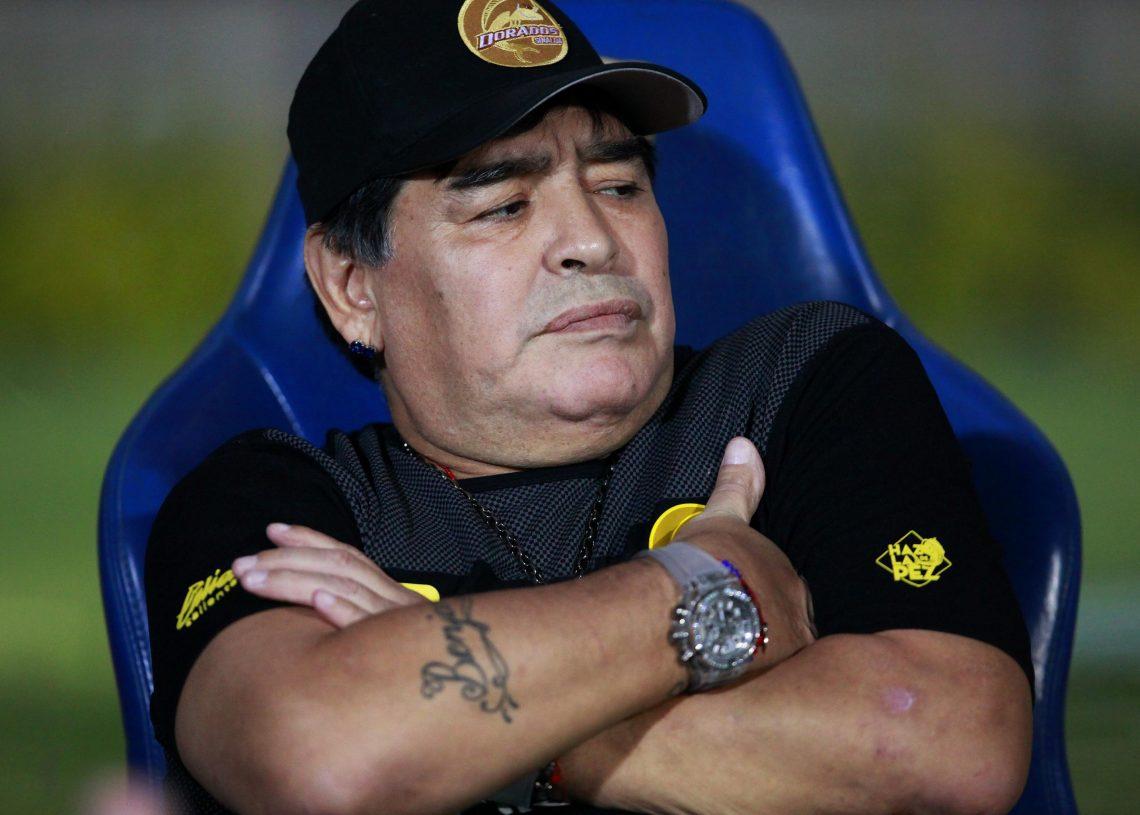 PHOTOS Maradona's face mask causes stir in Argentina ...