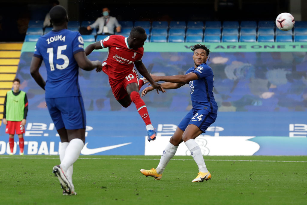 Liverpool's Senegalese striker Sadio Mane (C) heads the ball to score during the English Premier League football match between Chelsea and Liverpool at Stamford Bridge in London on September 20, 2020. (Photo by Matt Dunham / POOL / AFP) / RESTRICTED TO EDITORIAL USE. No use with unauthorized audio, video, data, fixture lists, club/league logos or 'live' services. Online in-match use limited to 120 images. An additional 40 images may be used in extra time. No video emulation. Social media in-match use limited to 120 images. An additional 40 images may be used in extra time. No use in betting publications, games or single club/league/player publications. /  (Photo by MATT DUNHAM/POOL/AFP via Getty Images)