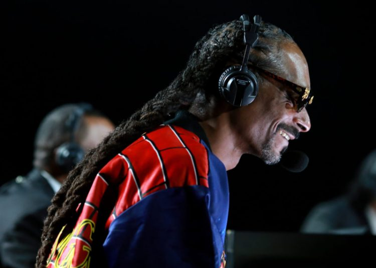 LOS ANGELES, CALIFORNIA - NOVEMBER 28: Snoop Dogg performs onstage during Mike Tyson vs Roy Jones Jr. presented by Triller at Staples Center on November 28, 2020 in Los Angeles, California. (Photo by Joe Scarnici/Getty Images for Triller)