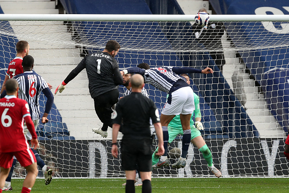 WEST BROMWICH, ENGLAND - MAY 16: Goalkeeper Alisson Becker of Liverpool scores a goal to make it 1-2 during the Premier League match between West Bromwich Albion and Liverpool at The Hawthorns on May 16, 2021 in West Bromwich, United Kingdom. (Photo by Adam Fradgley - AMA/West Bromwich Albion FC via Getty Images)
