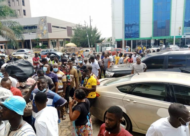 Fans of Hearts of Oak and Asante Kotoko gather at the outlets to purchase tickets for the Super Clash - Photo: Oyerepa Sports
