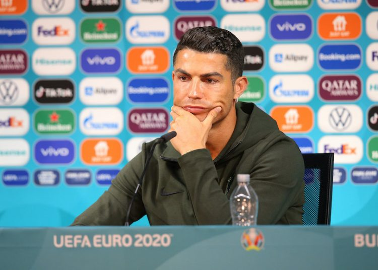 BUDAPEST, HUNGARY - JUNE 14: In this Handout picture provided by UEFA, Cristiano Ronaldo of Portugal speaks to the media during the Portugal Press Conference ahead of the Euro 2020 Group F match between Hungary and Portugal at Puskas Arena on June 14, 2021 in Budapest, Hungary. (Photo by UEFA/UEFA via Getty Images)